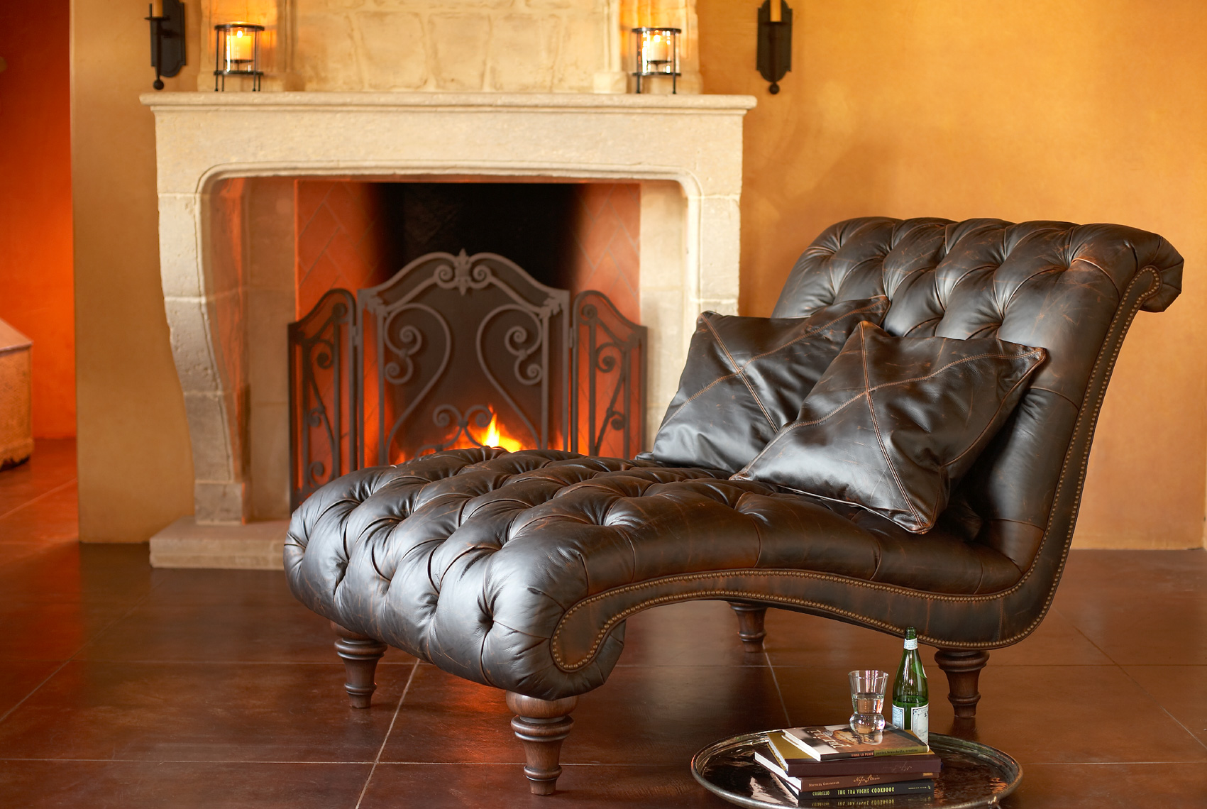 living room interior with brown leather chaise lounge sofa and white fireplace