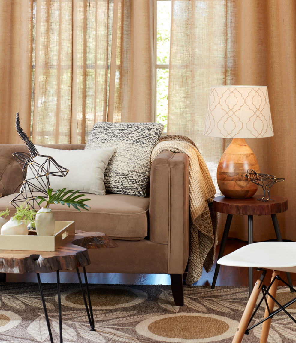 living room interior with light brown couch and orange curtains San Francisco interior photographer