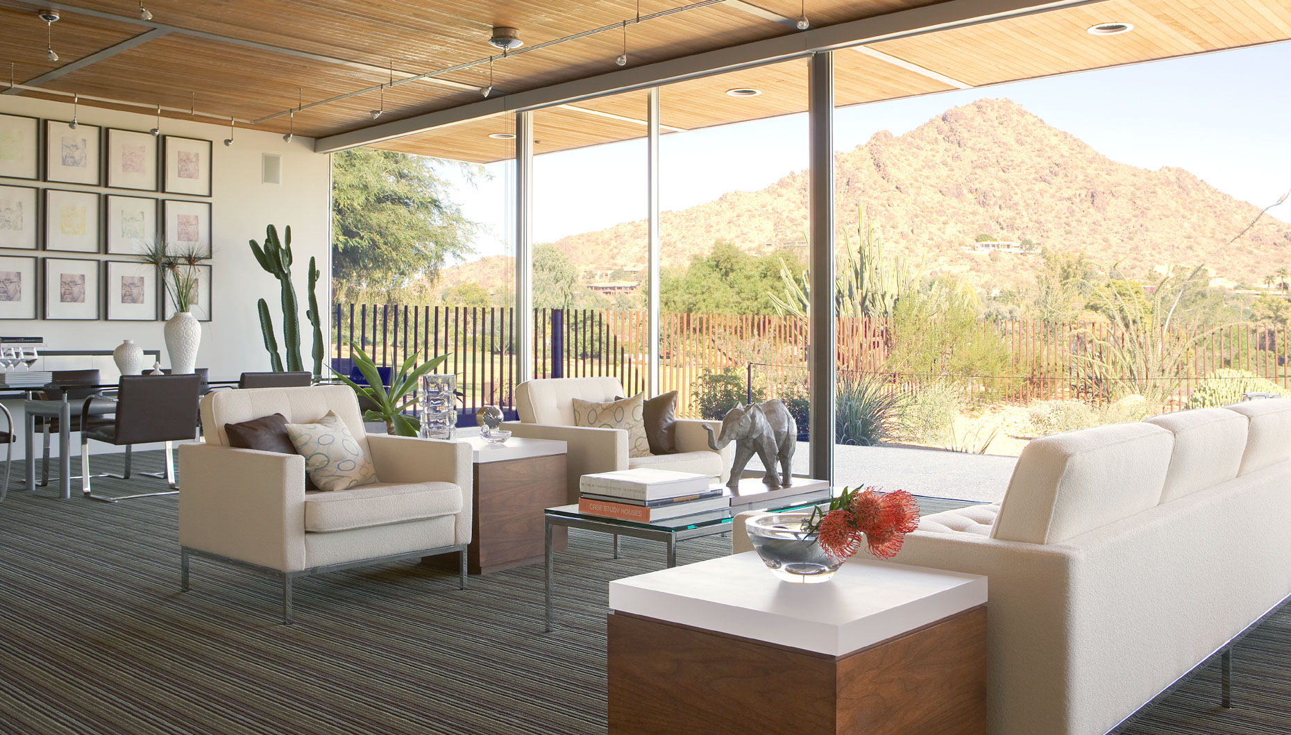 living room with white couches and view of desert landscape