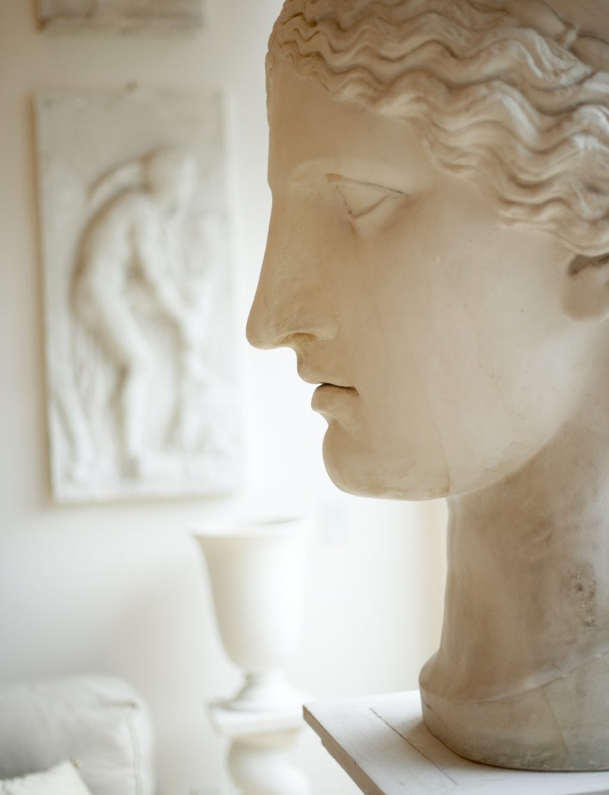 white sculpted head and neck on white platform San Francisco interior photographer