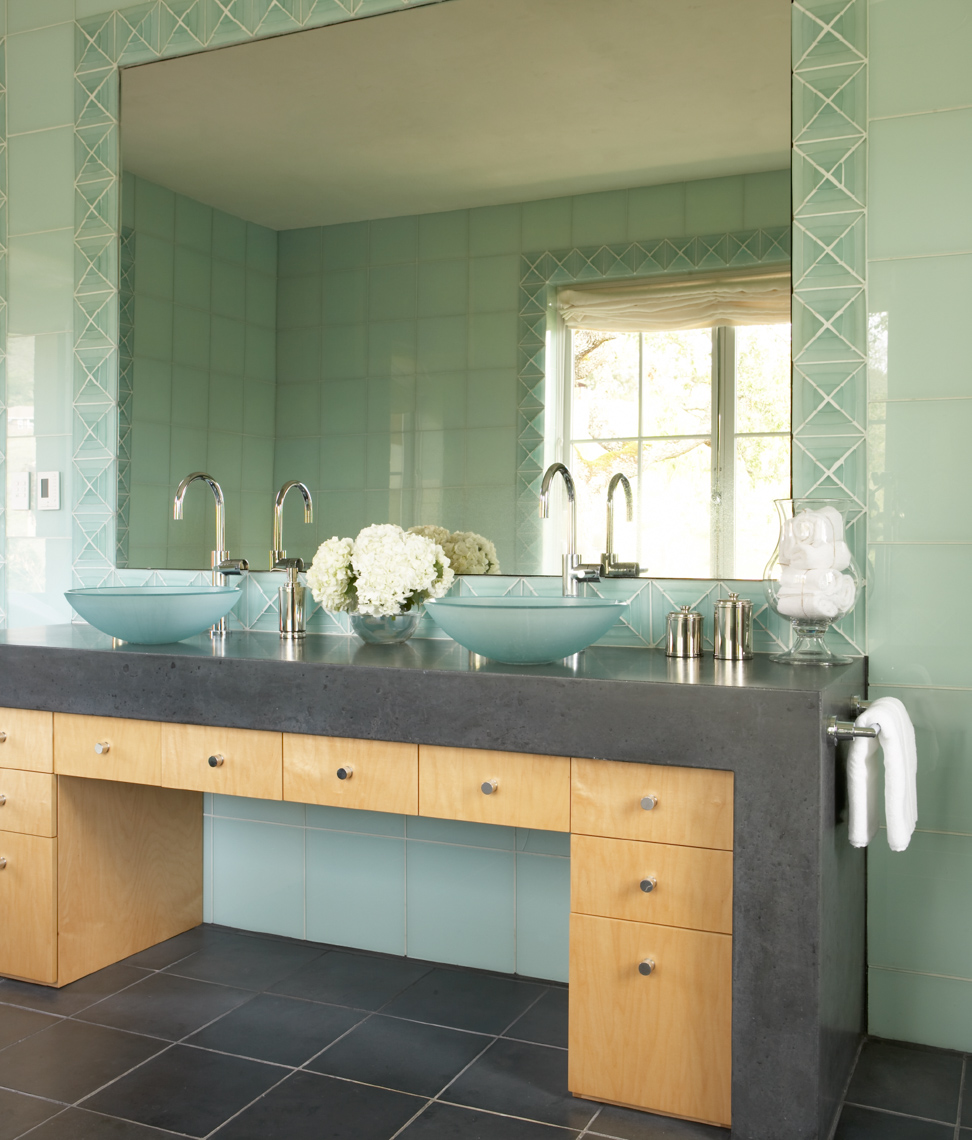 bathroom interior with grey countertops and sea green wall tiles