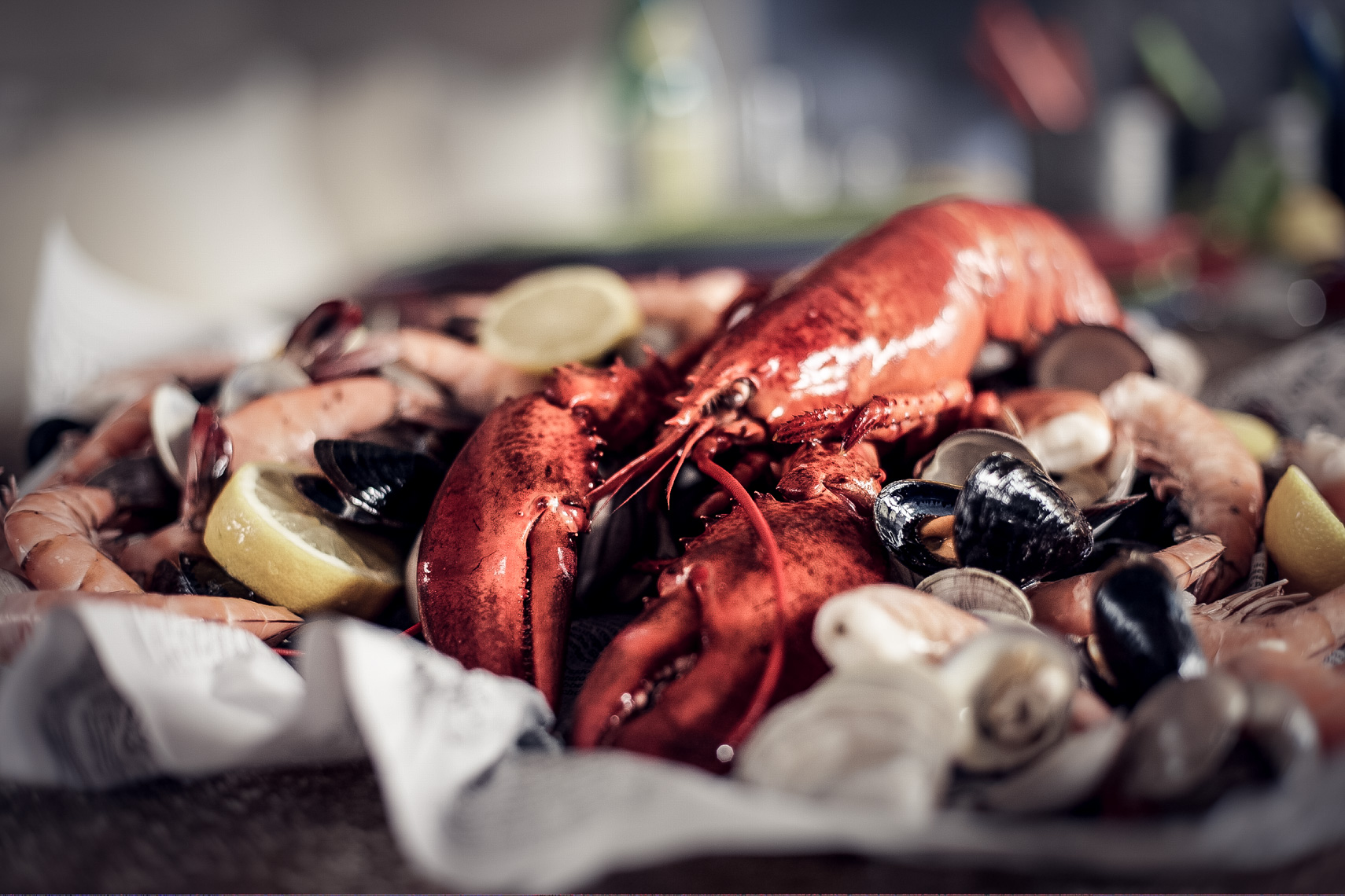 whole lobster with lemon and muscles and seafood