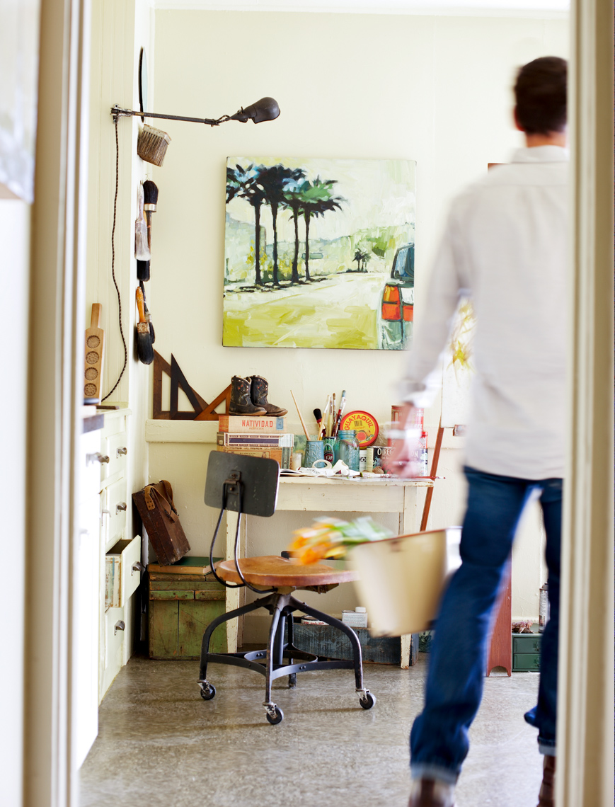Man in white shirt enters art studio carrying a basket San Francisco lifestyle photographer