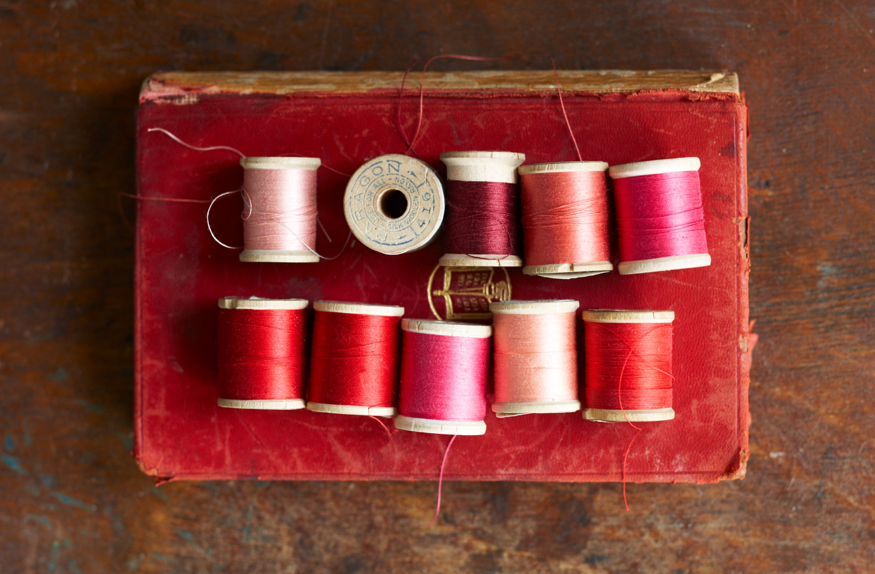 Spools of thread on book hilip Harvey Photography, San Francisco, California, still life, interiors, food, lifestyle and product photography