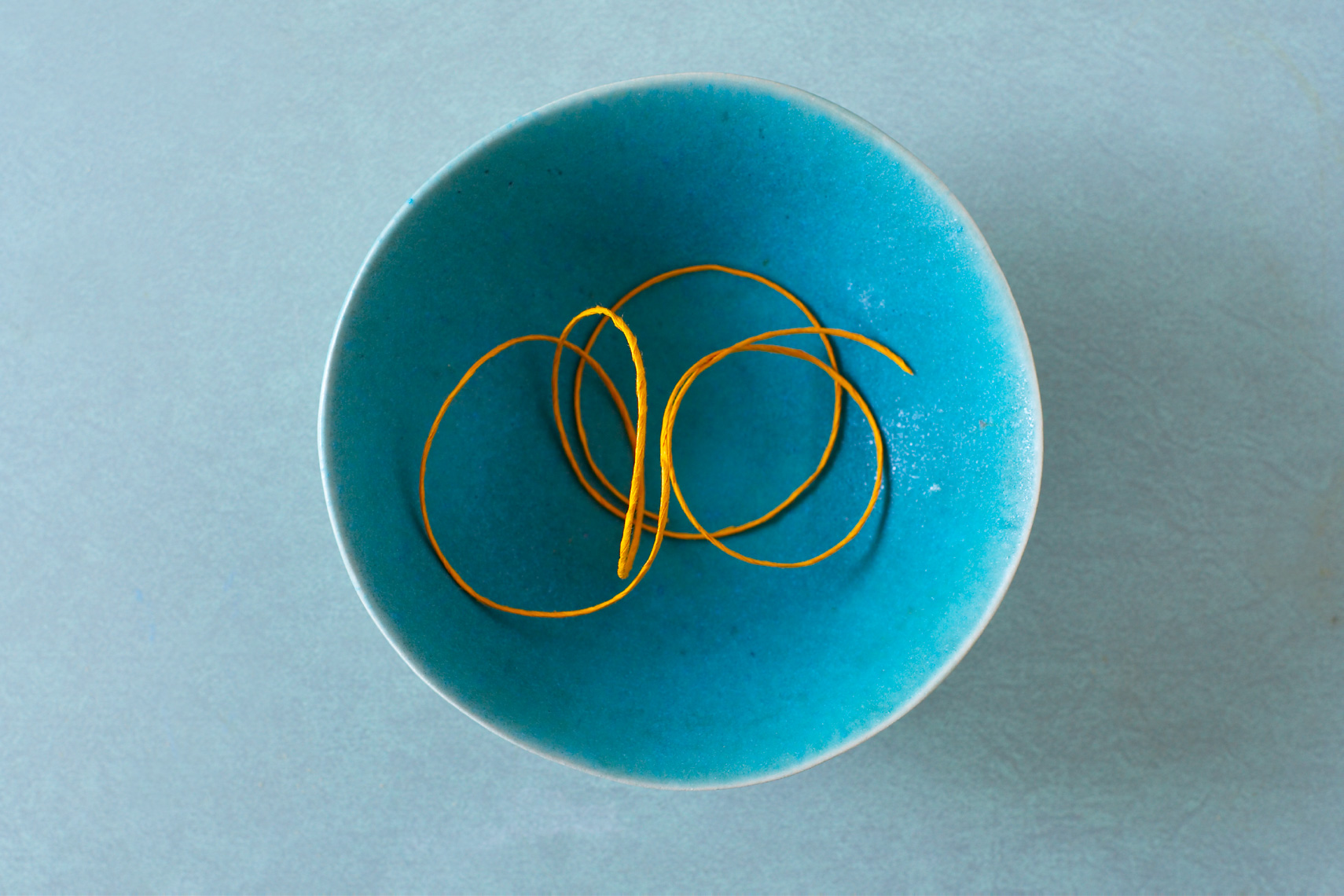 String in blue bowl hilip Harvey Photography, San Francisco, California, still life, interiors, food, lifestyle and product photography San Francisco product photographer