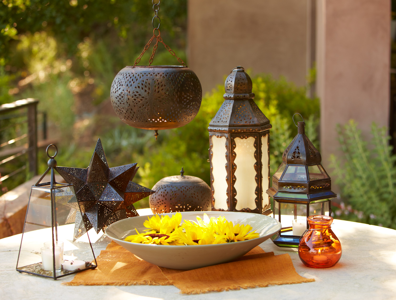 Moroccan lantern collection with yellow sunflowers in ceramic bowl San Francisco lifestyle photographer