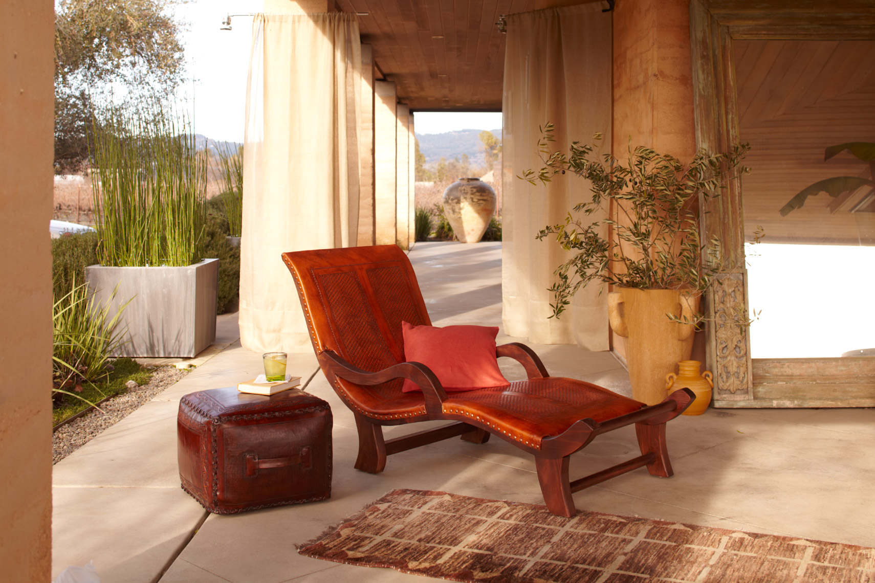 Leather and wood chaise chair on tile patio with rug San Francisco lifestyle photographer