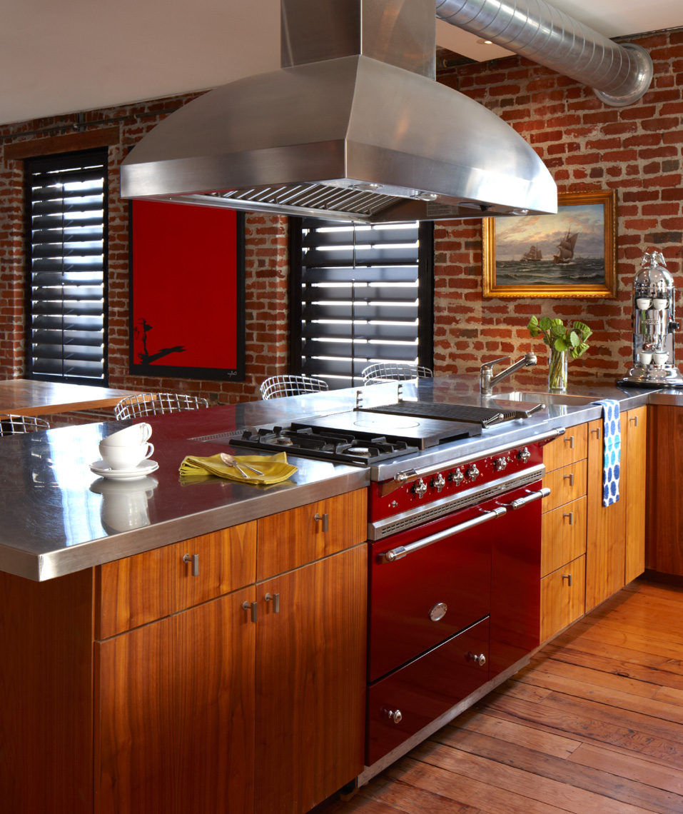 wooden kitchen interior with red brick walls and red stove San Francisco interior photographer