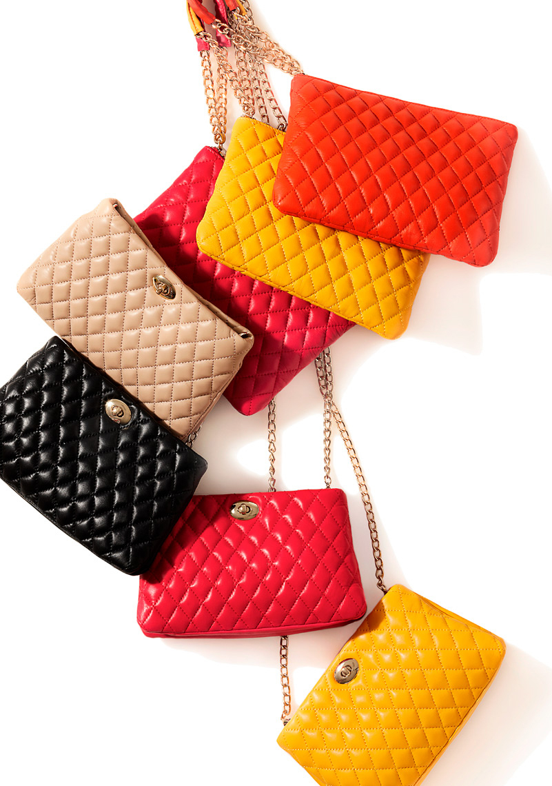 7 colorful handbags hanging with gold chains San Francisco product photographer