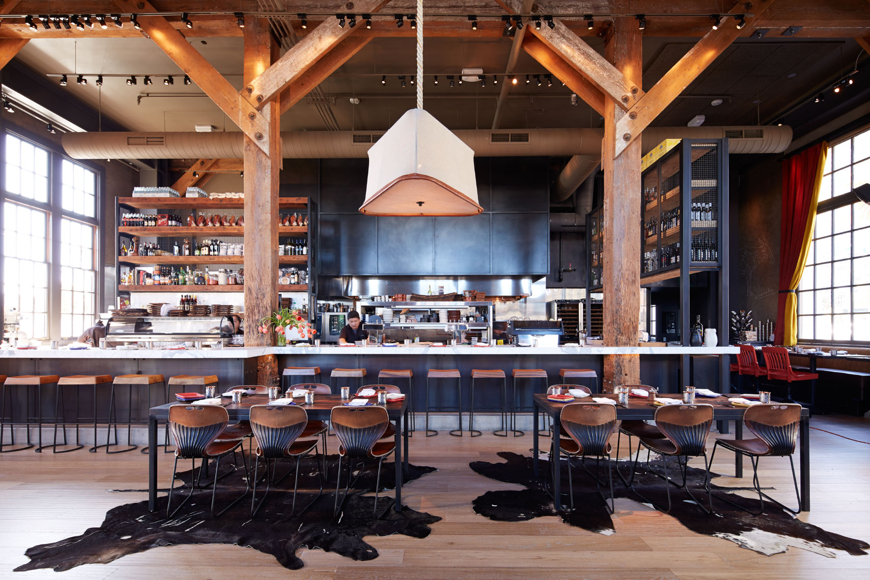 dining and restaurant area with high ceilings and cow fur rugs San Francisco interior photographer