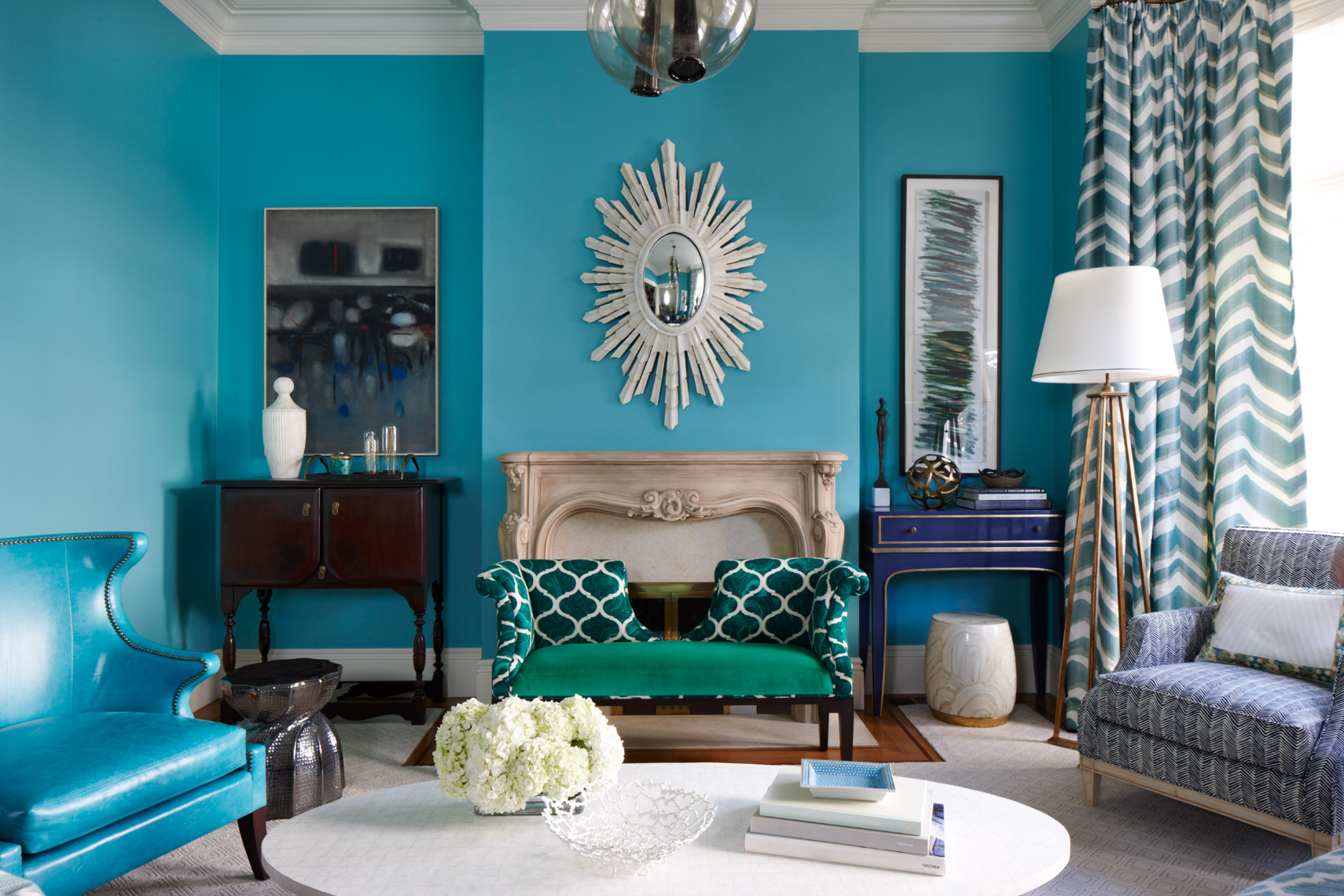 living room with blue walls and blue furniture