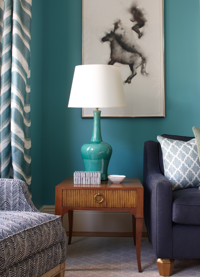 living room with blue lamp and white lampshade with blue walls