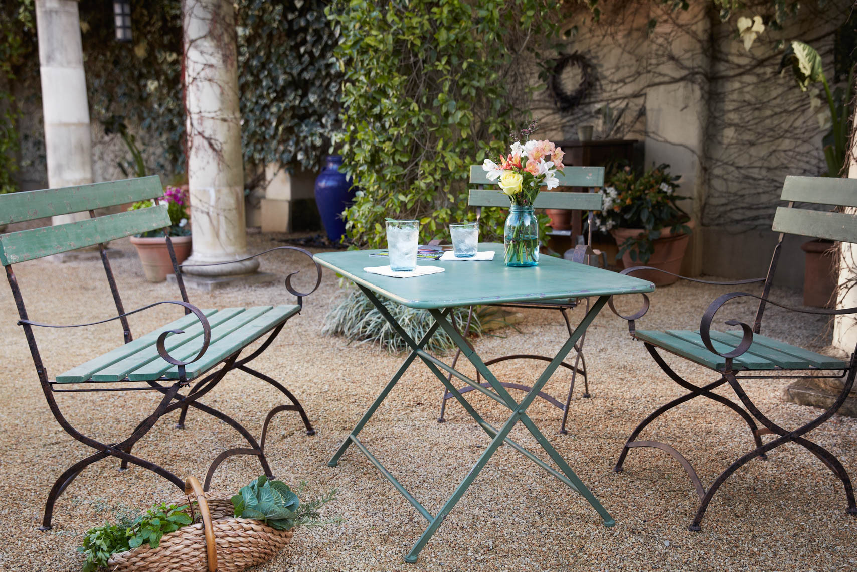 Green bistro furniture breakfast setting on pea gravel in yard San Francisco lifestyle photographer