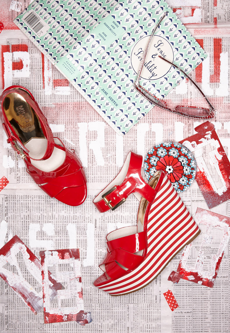shiny red platform shoes with red and white stripes with blue notebook and sunglasses San Francisco product photographer