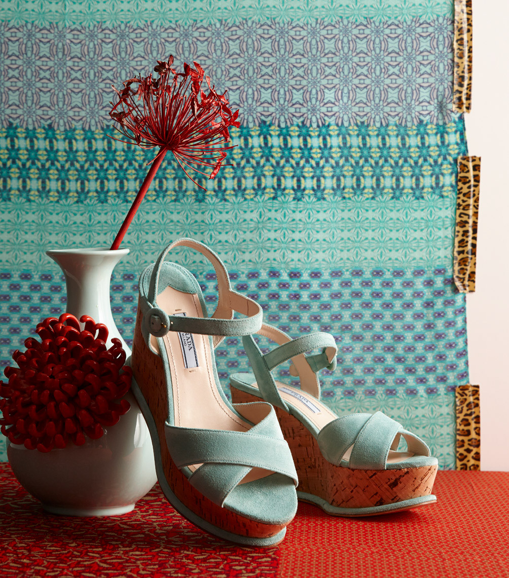 blue platform shoes with white vase and red flower