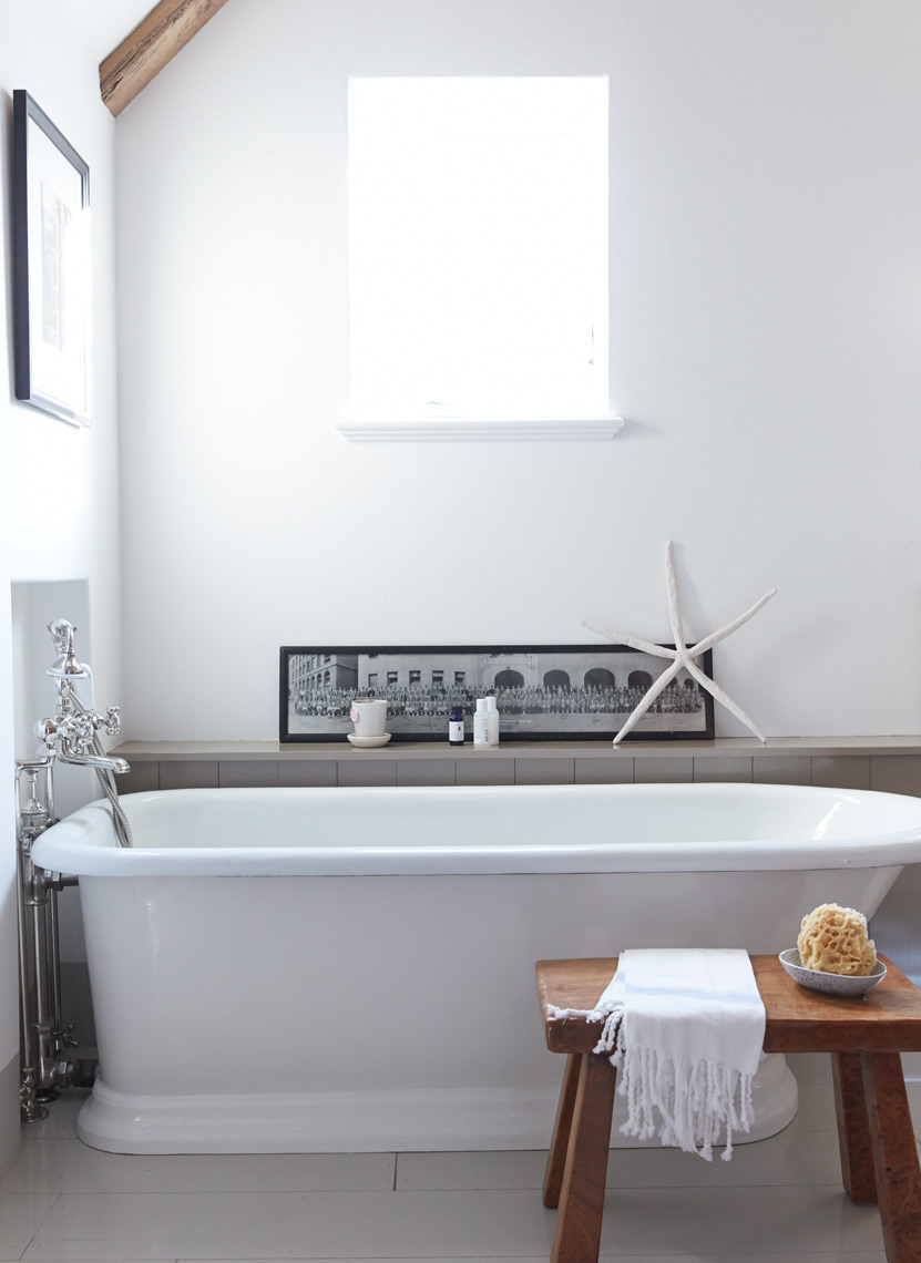 bathroom with white bathtub and small wooden bench with white towel San Francisco interior photographer