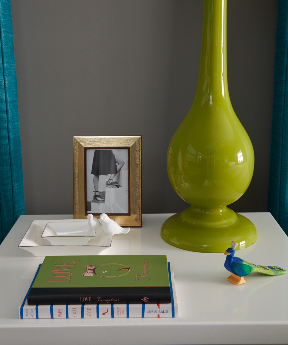 bedside table with green vase and small stack of books and framed photograph San Francisco interior photographer