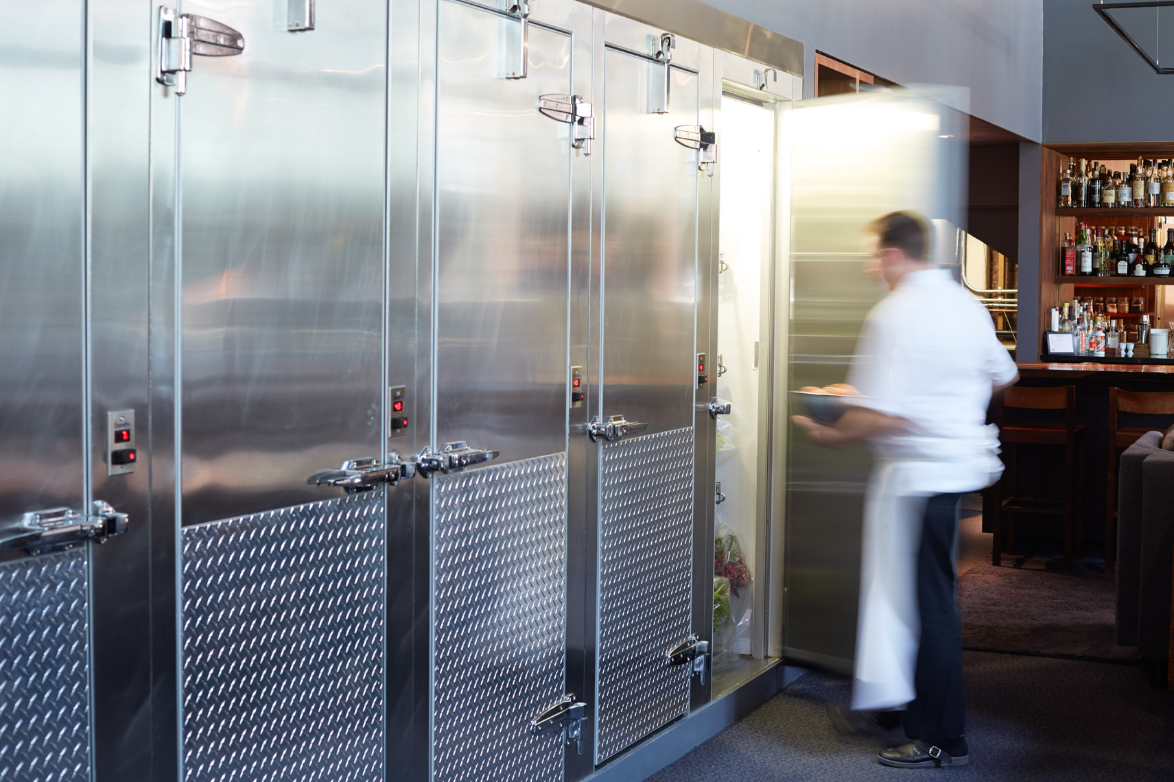 Chef in white apron opening stainless refrigerator door San Francisco lifestyle photographer