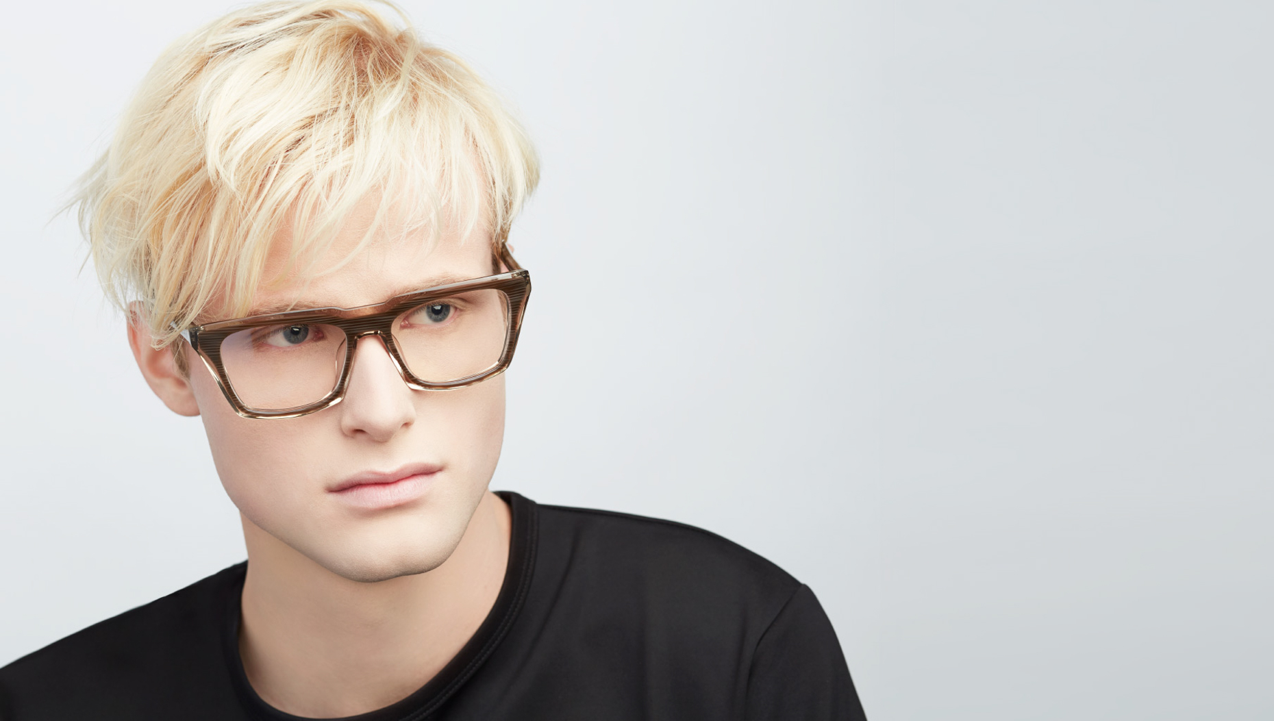 blonde man wearing brown rectangular frames