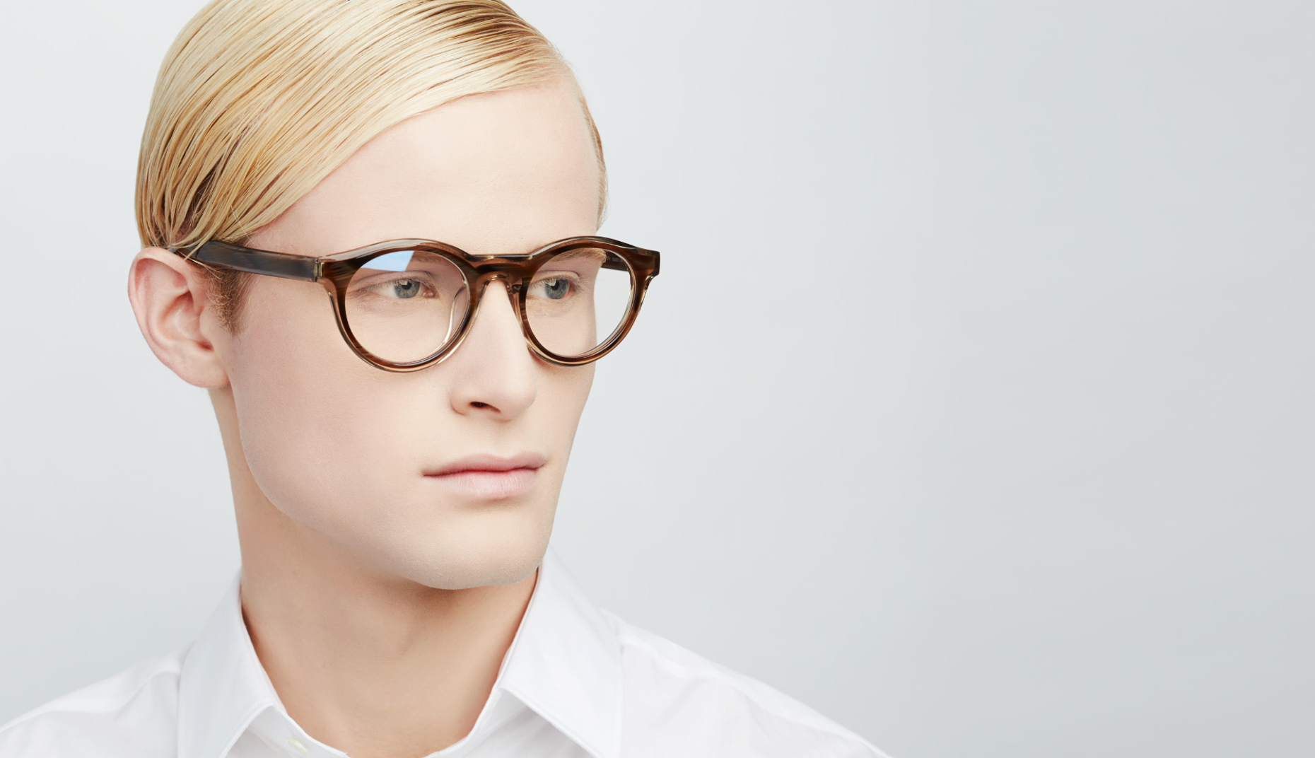 blonde man wearing brown circular glasses San Francisco fashion photographer