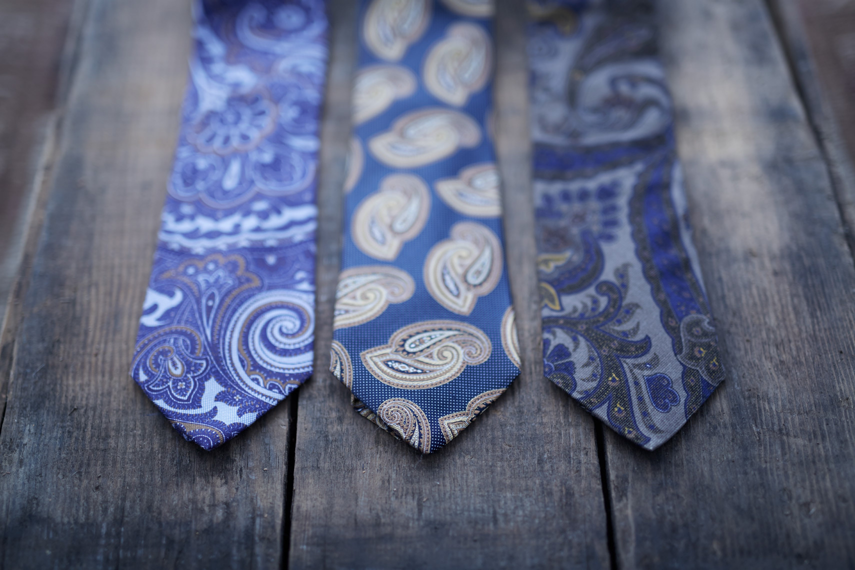navy ties with floral design on wooden dock San Francisco product photographer