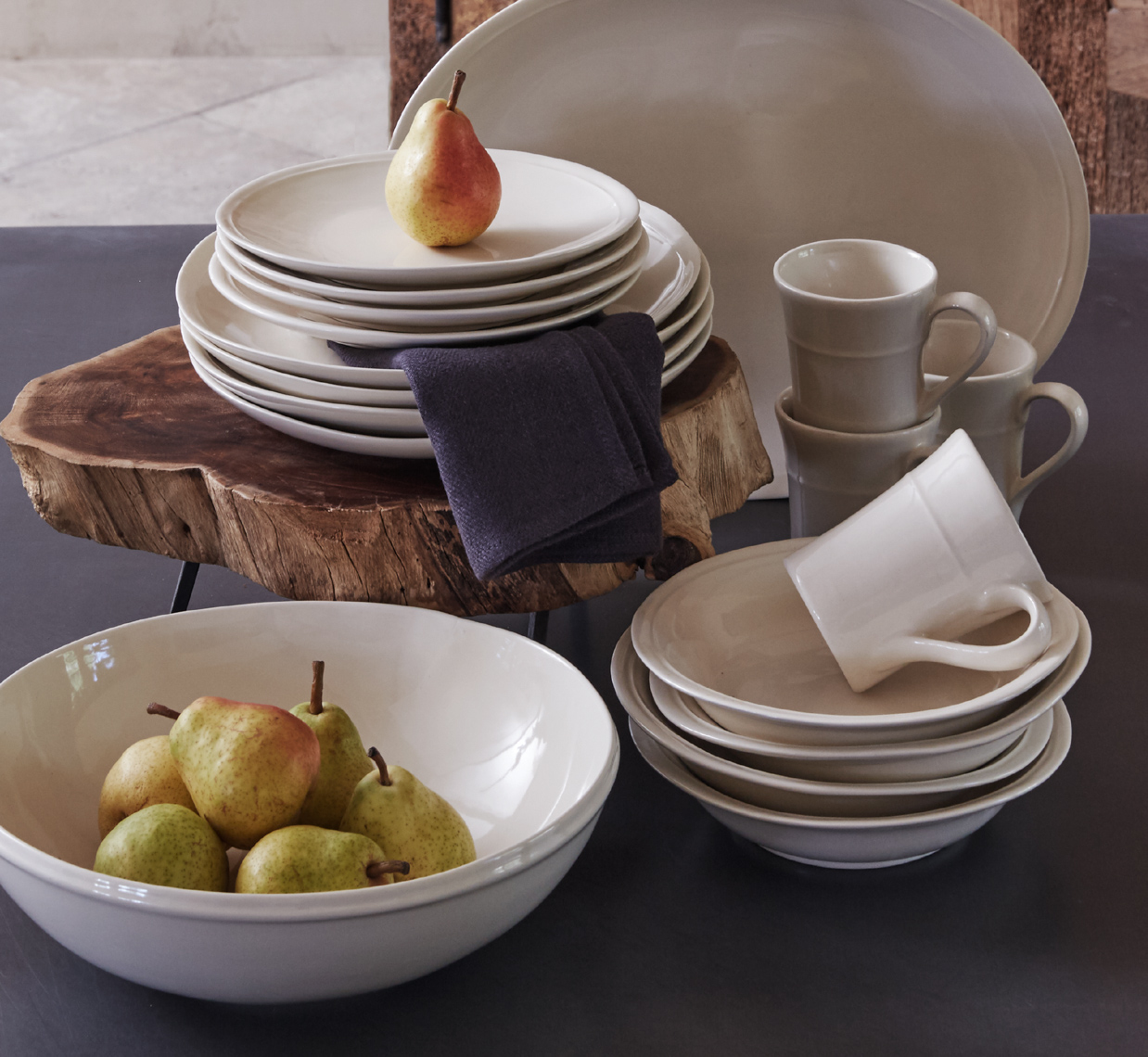 white ceramic bowl with pears and a stack of plates with a pear on top San Francisco interior photographer