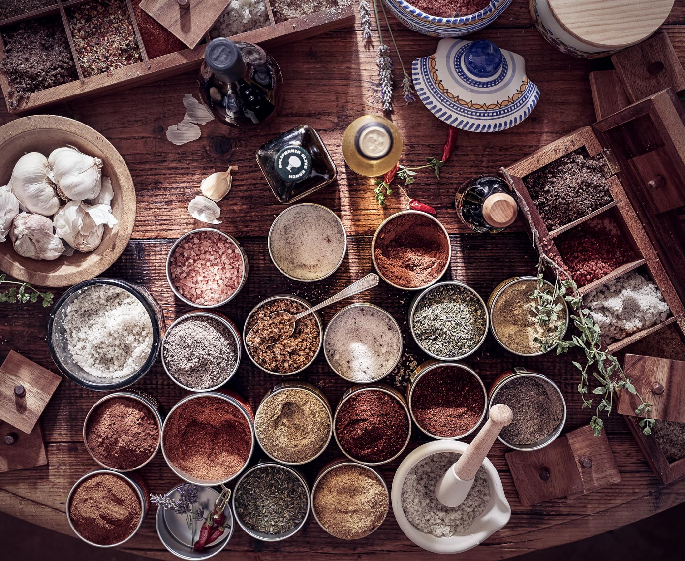 collection of spices and garlic on wooden table