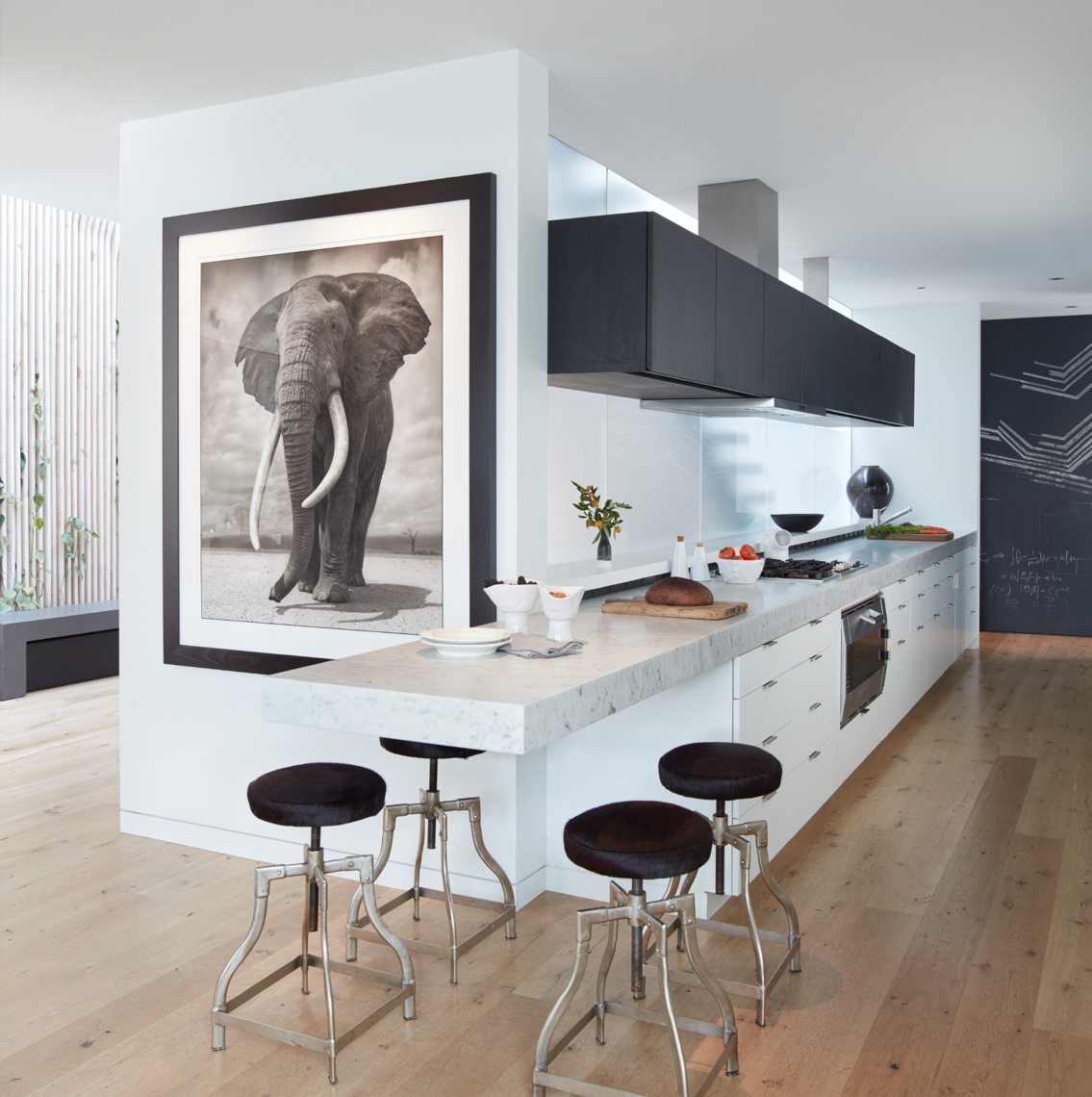 modern home kitchen interior seating area with black stools and white marble countertop  San Francisco interior photographer