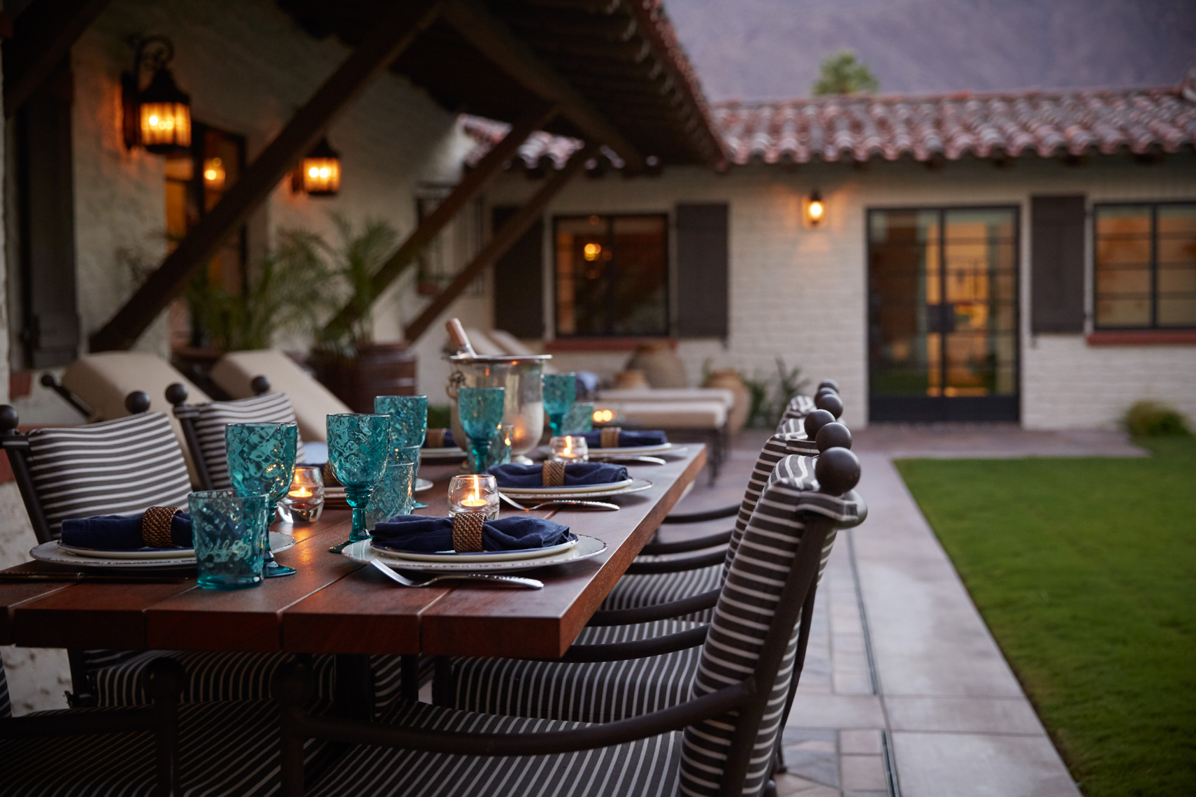 Courtyard dinning table set with glassware and chairs