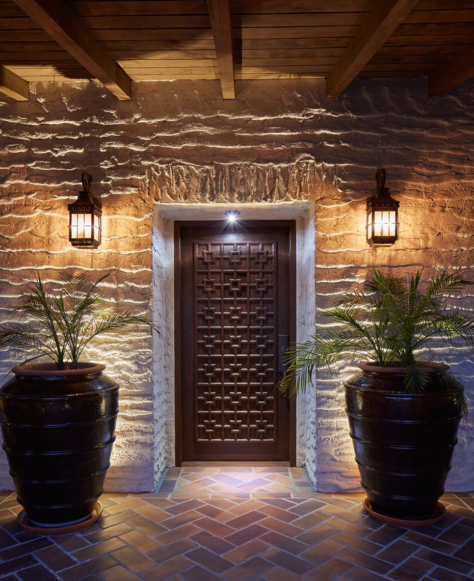 Palm Springs stone entryway at dusk with potted plants San Francisco architectural photographer