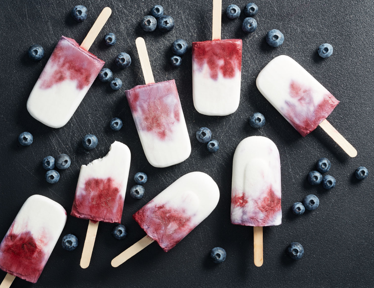 white and red blueberry popsicles  with fresh blueberries