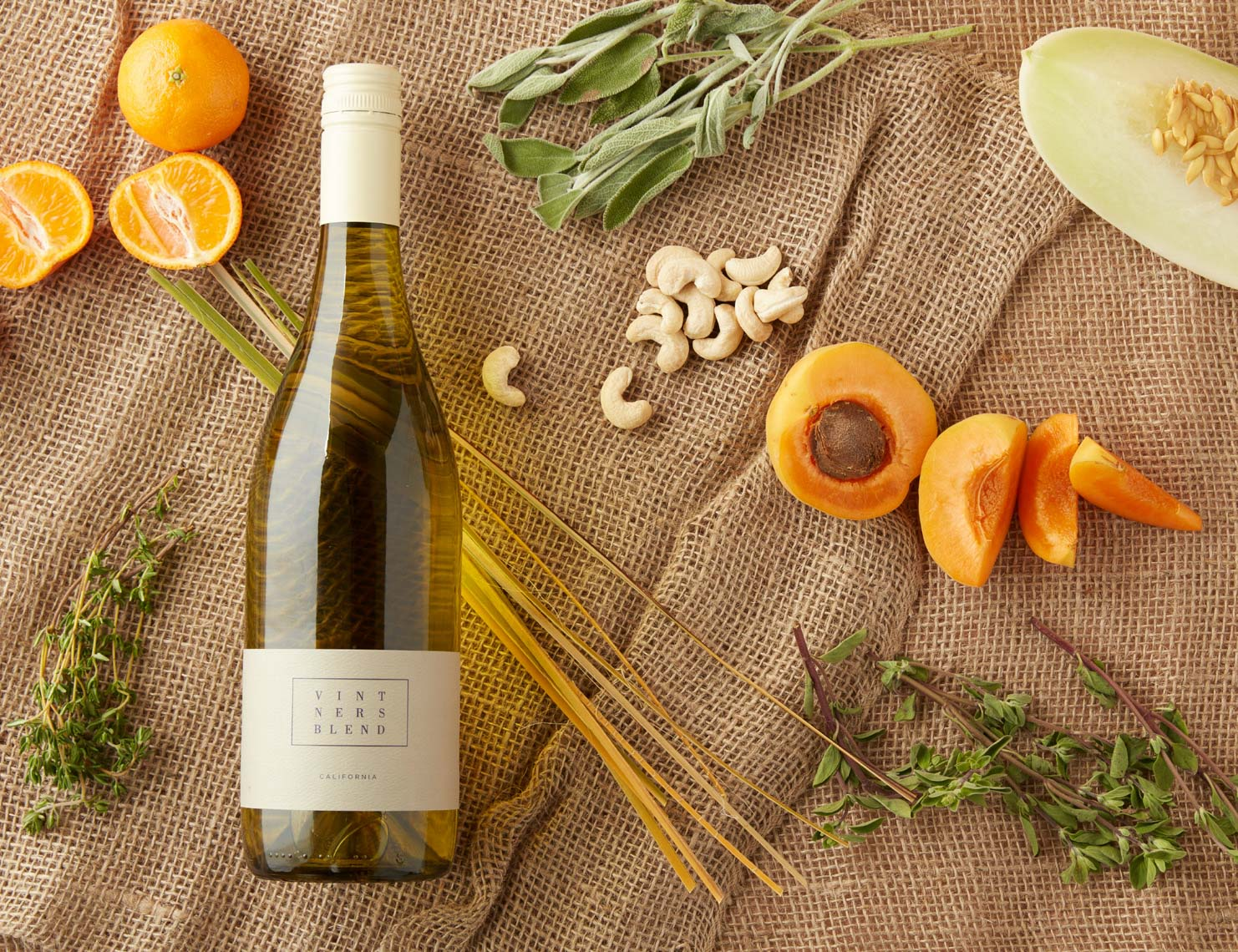 bottle of Peju with orange slices and apricots and nuts and herbs San Francisco food photographer
