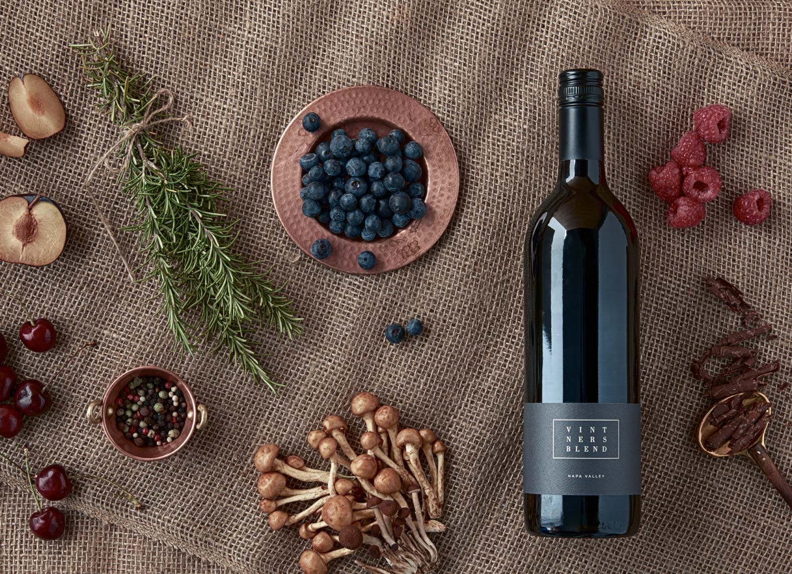 bottle of red wine with fresh fruit and herbs and mushrooms San Francisco food photographer