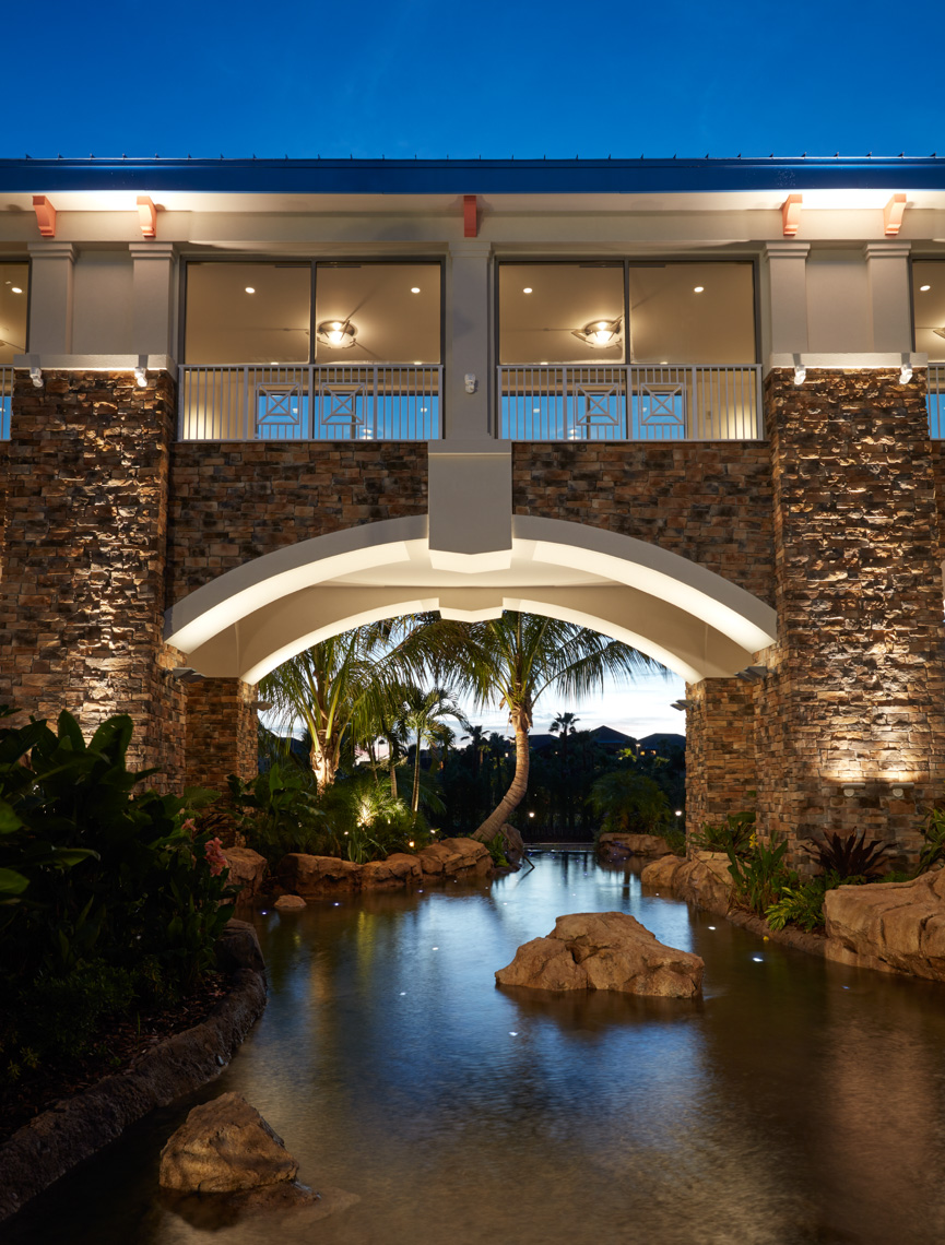 Resort raised walkway with lagoon and reflections below at dusk San Francisco architectural photographer