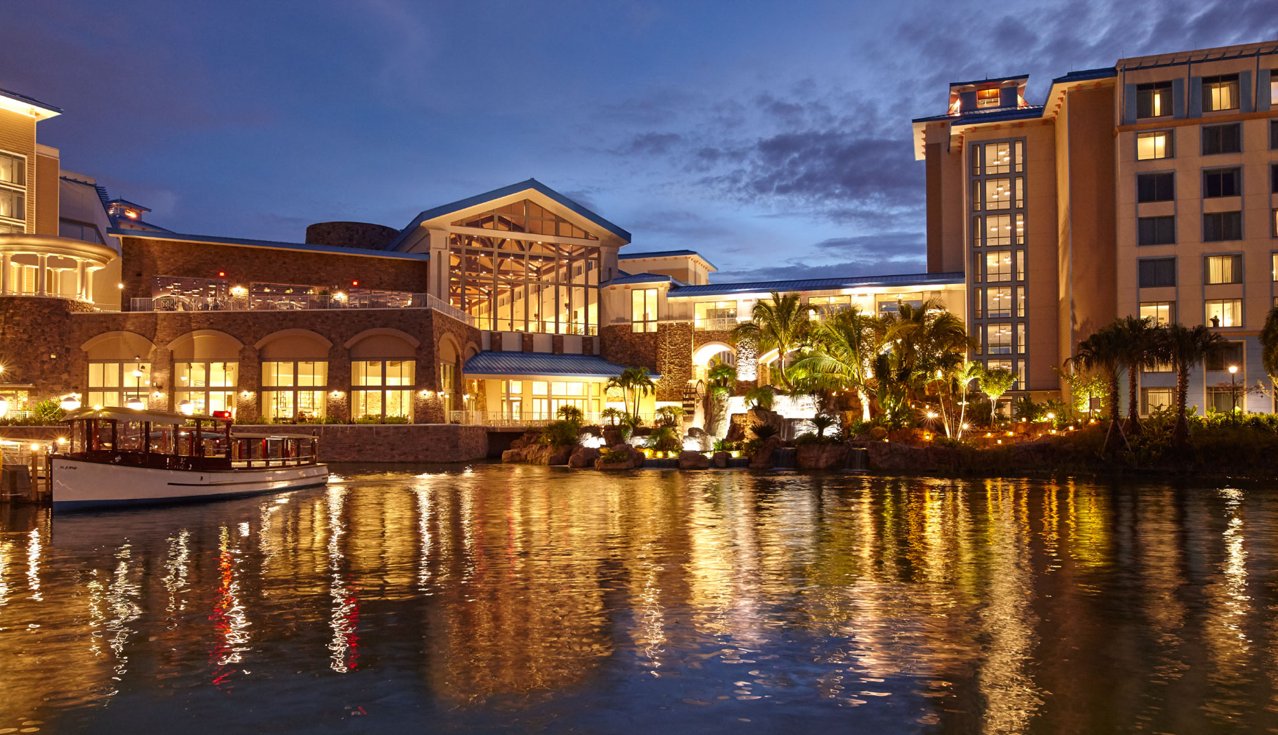 Florida hotel and resort at night viewed over lagoon with reflections