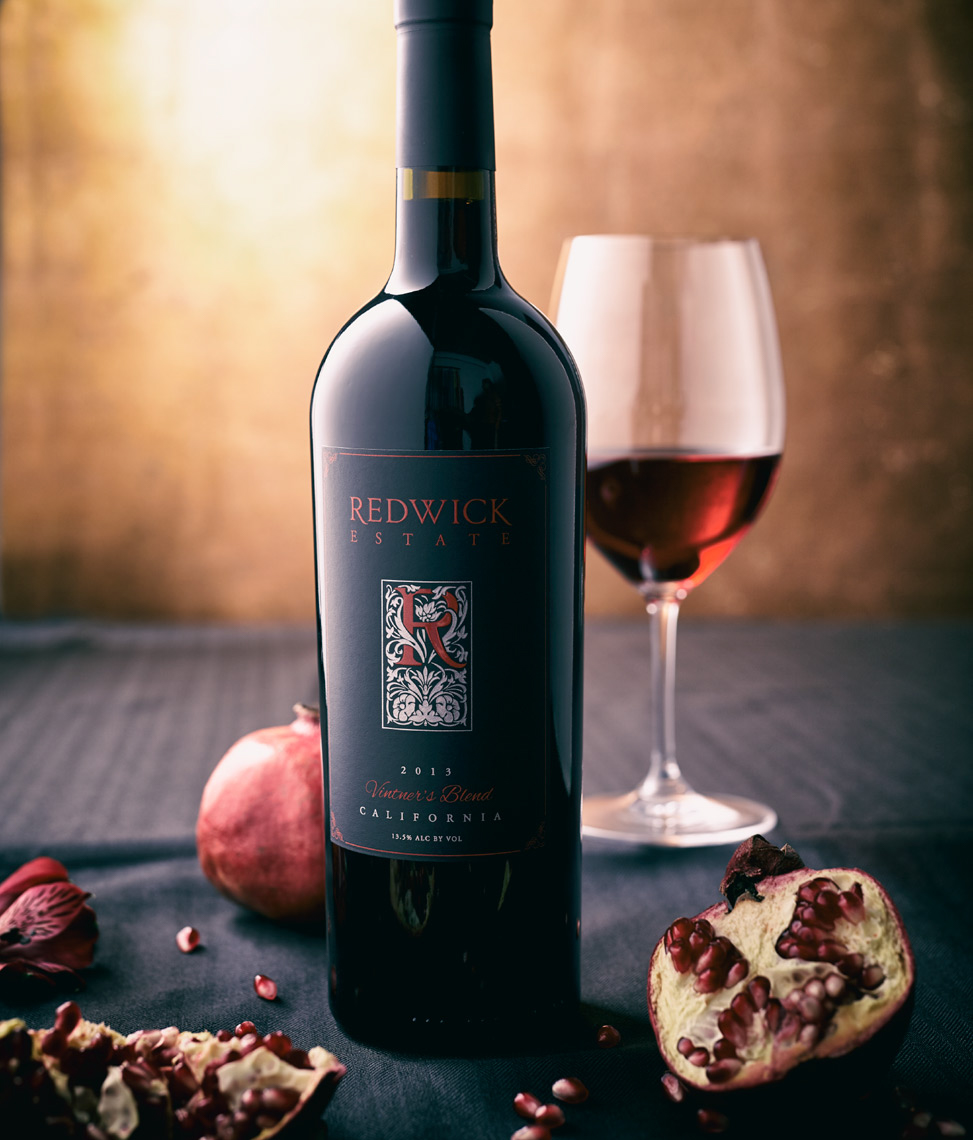 bottle and glass with wine and pomegranates San Francisco food photographer