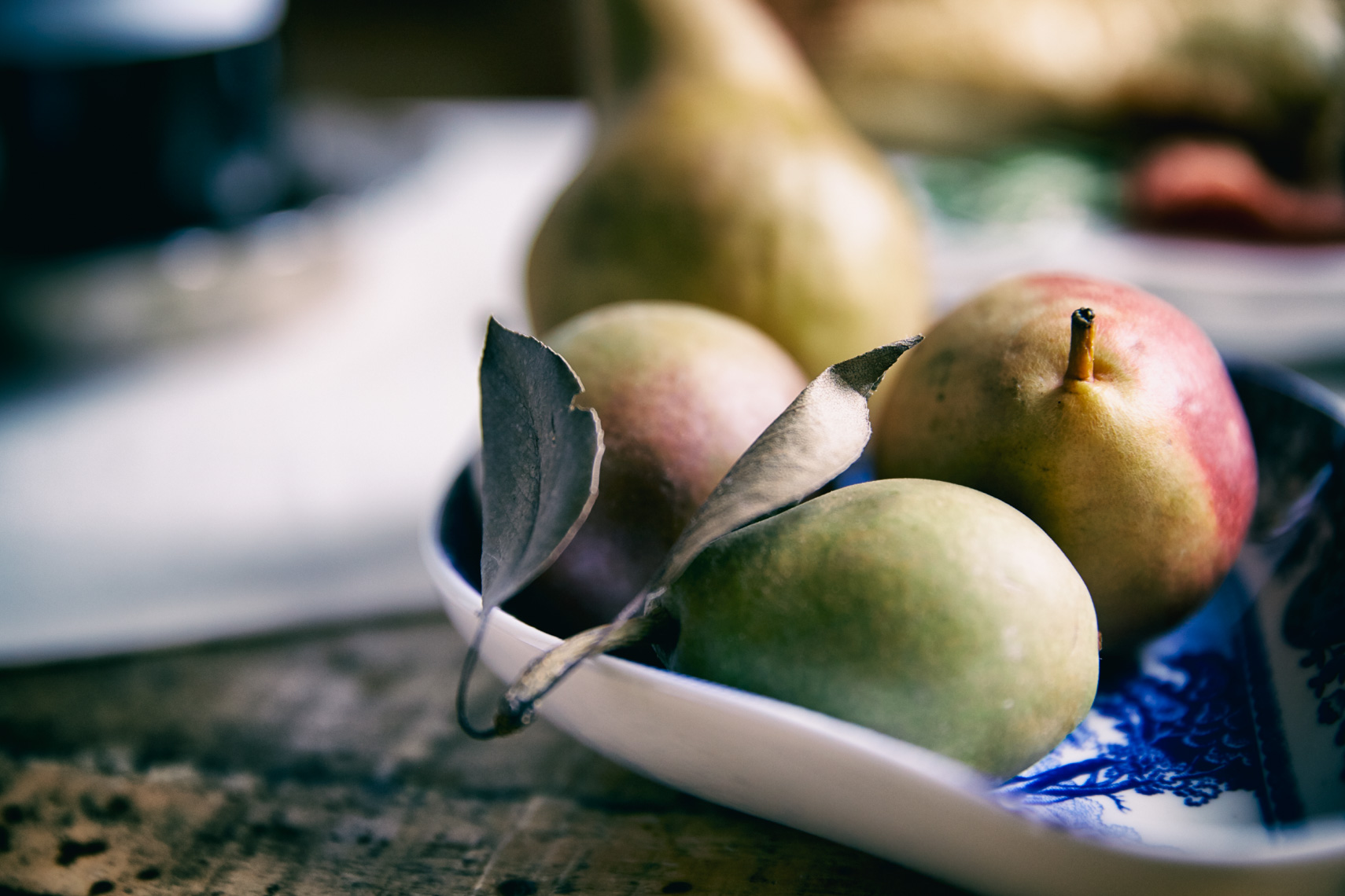 Pears with leaves in bowl hilip Harvey Photography, San Francisco, California, still life, interiors, food, lifestyle and product photography San Francisco product photographer