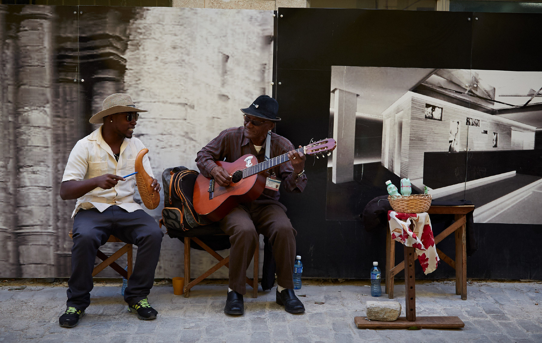 band smiling and playing music in Cuba