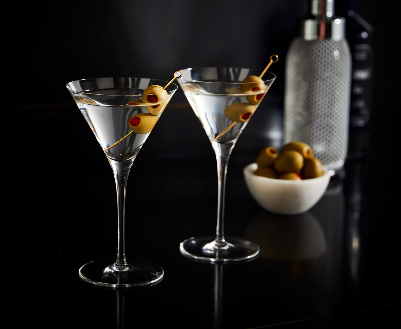 2 martini glasses with olives