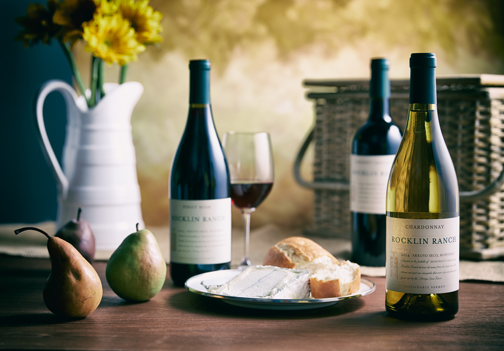 cheese plate with bread and pears and 3 bottles of wine San Francisco food photographer