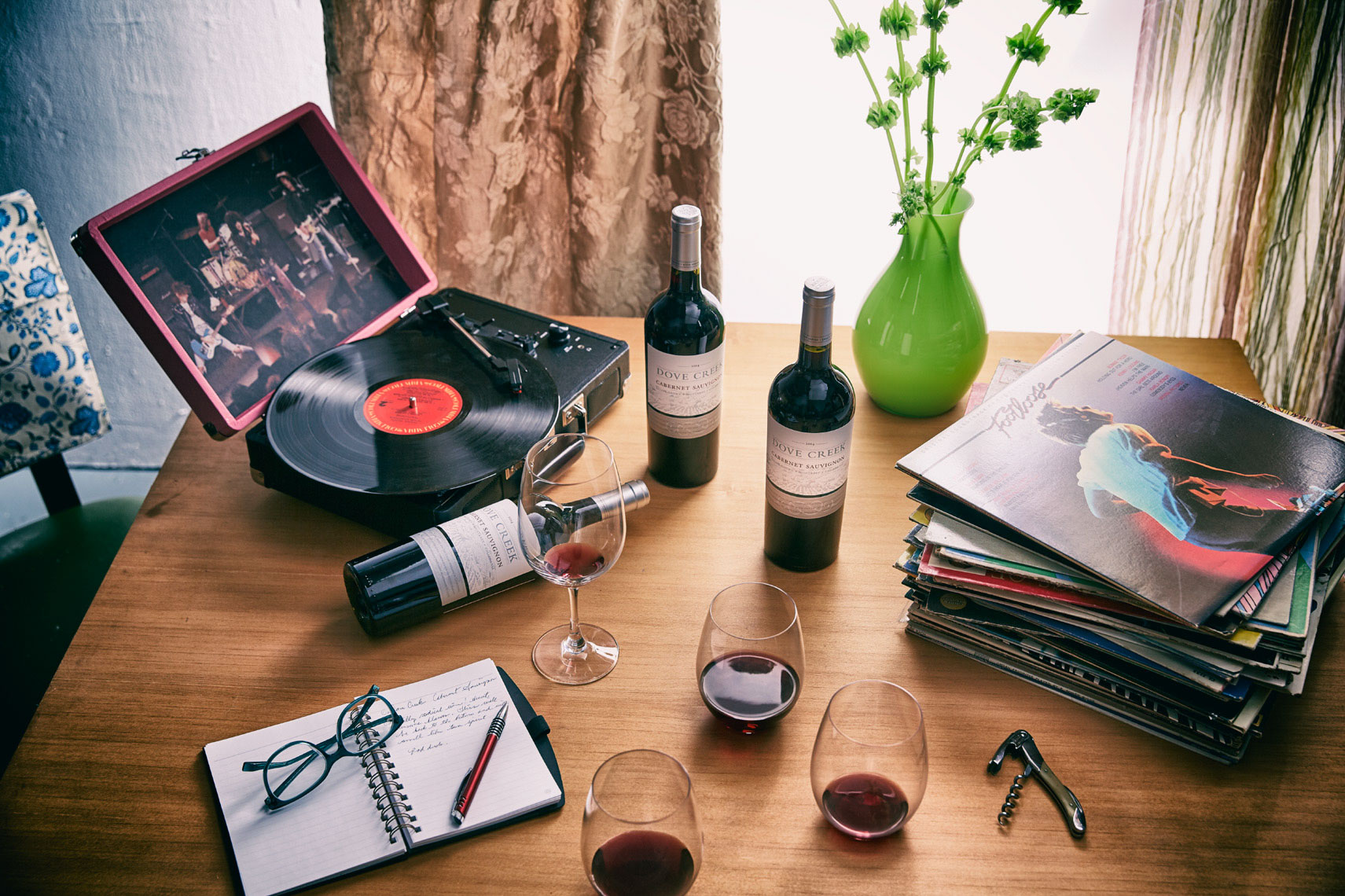 table with 3 bottles of wine and wine glasses with a record player San Francisco lifestyle photographer