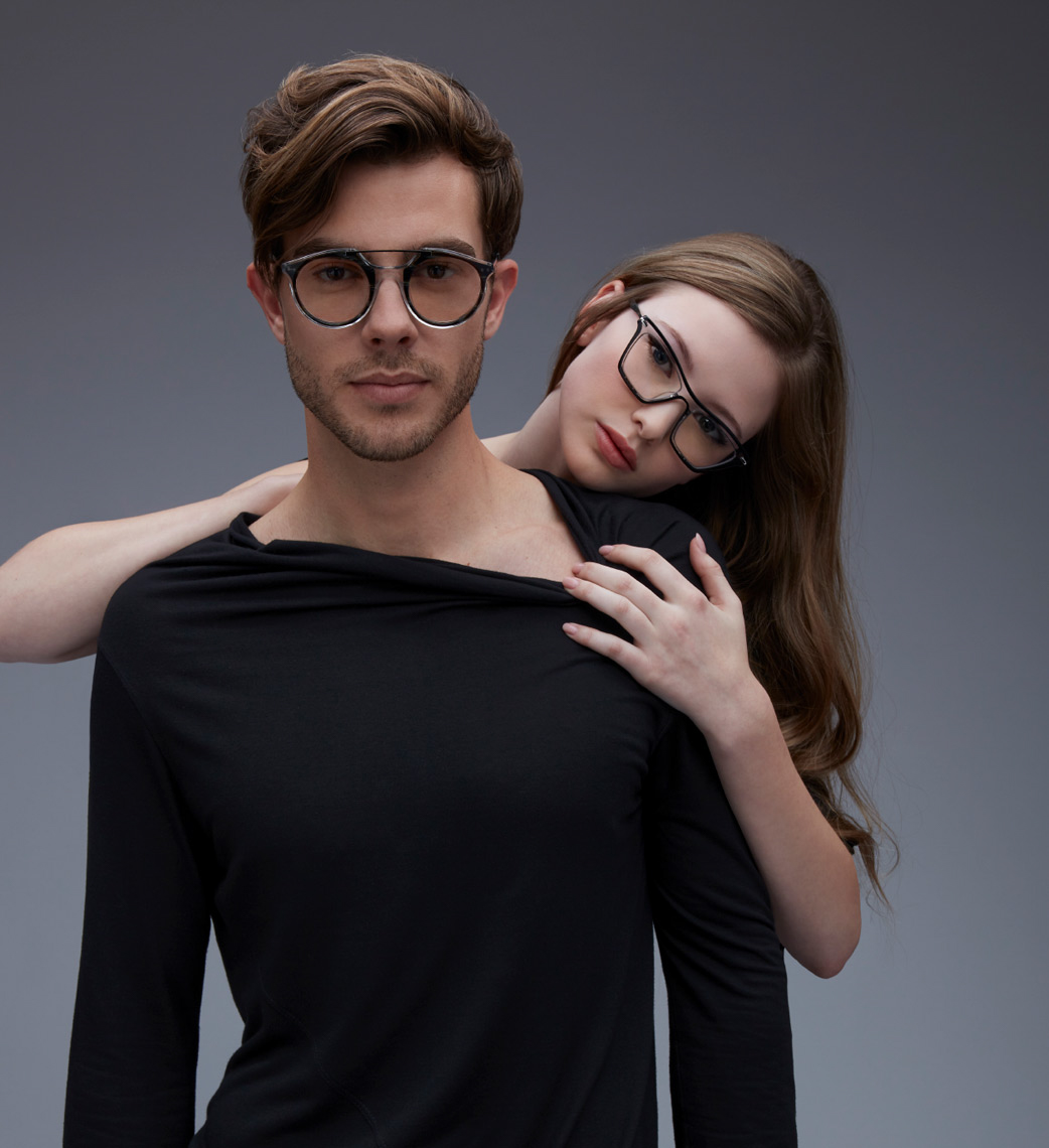 woman holding man wearing glasses