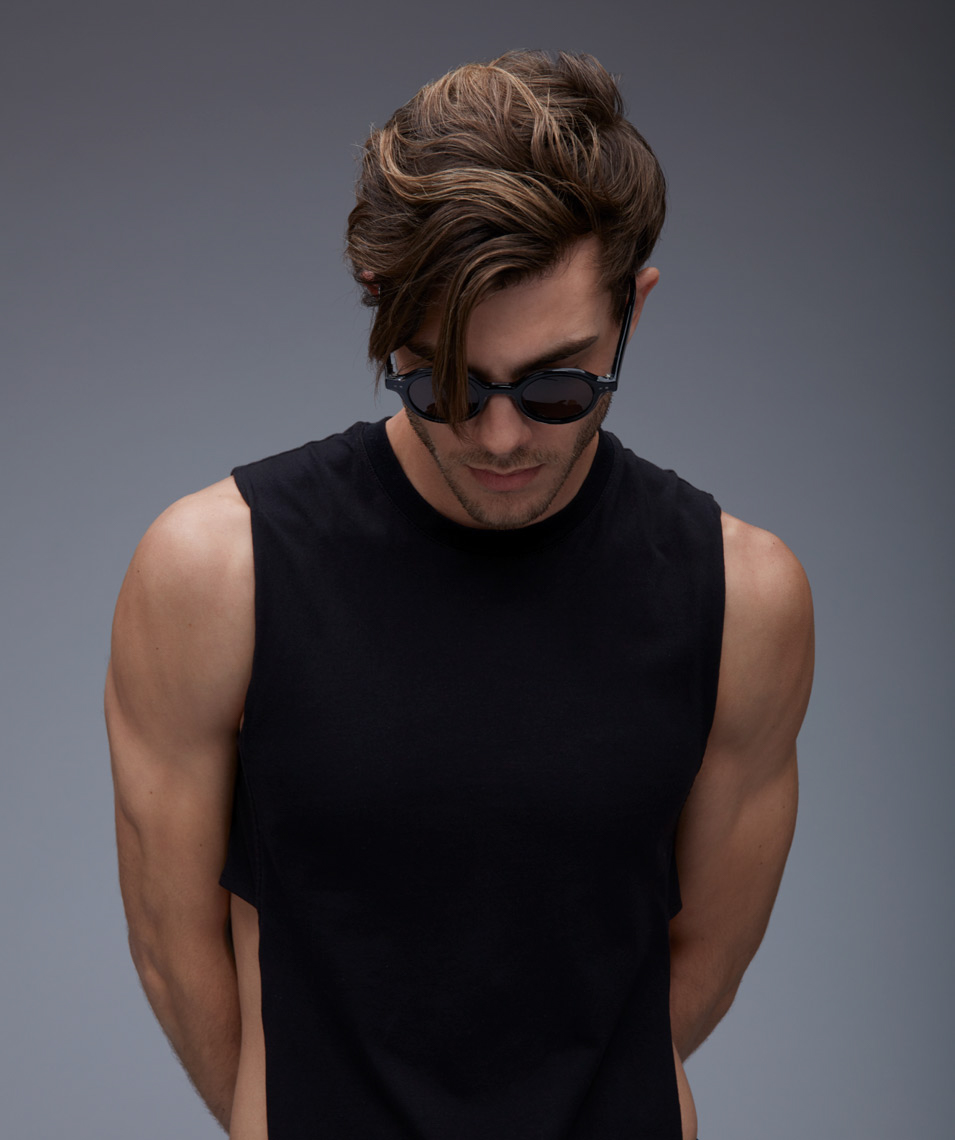 man wearing black tank shirt and dark circular shades San Francisco fashion photographer