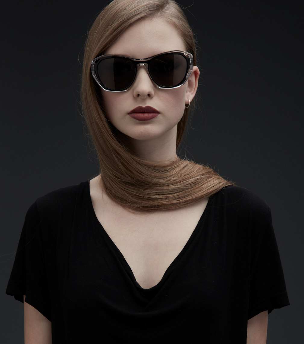 woman wearing large dark glasses with hair wrapped around her neck San Francisco fashion photographer