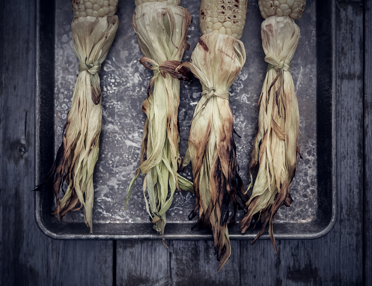 grilled corn husks on silver tray San Francisco food photographer