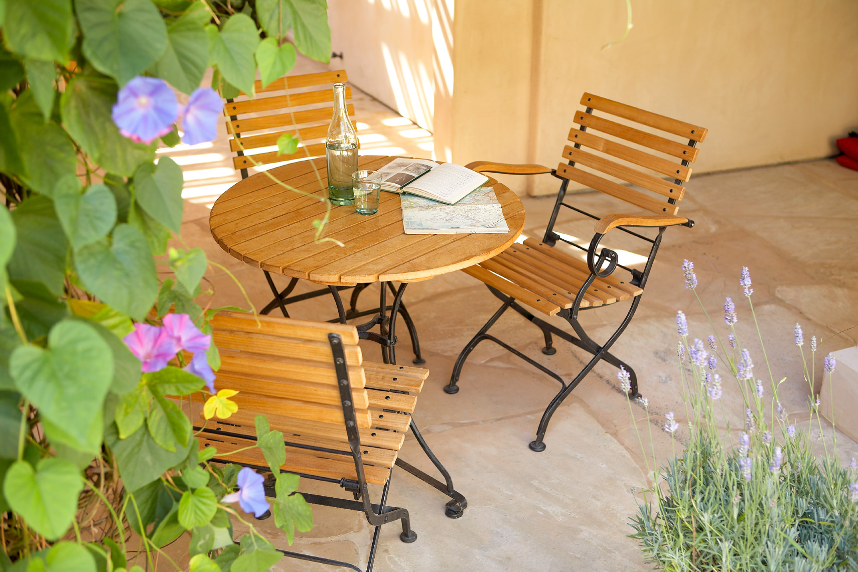 Wood and metal cafe furniture on stone patio San Francisco product photographer