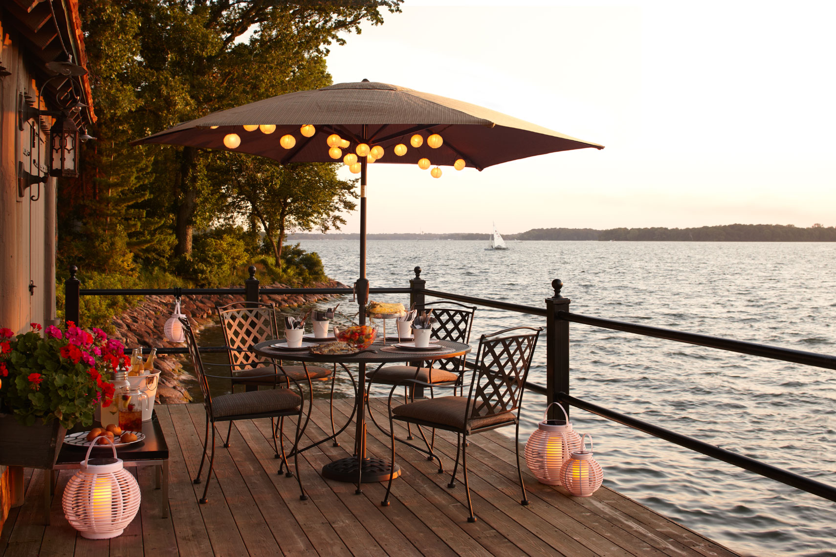 Outdoor seating collection on dock with brown umbrella on a lake