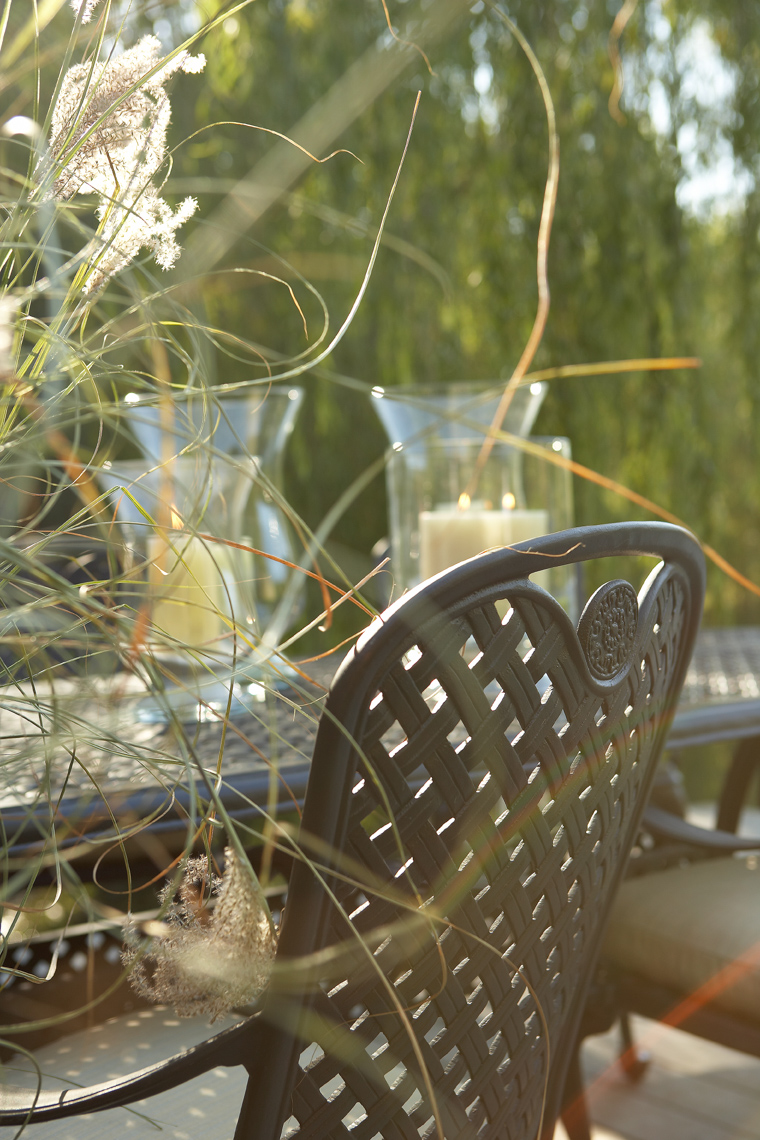 Detail of black metal chair at outdoor dining table