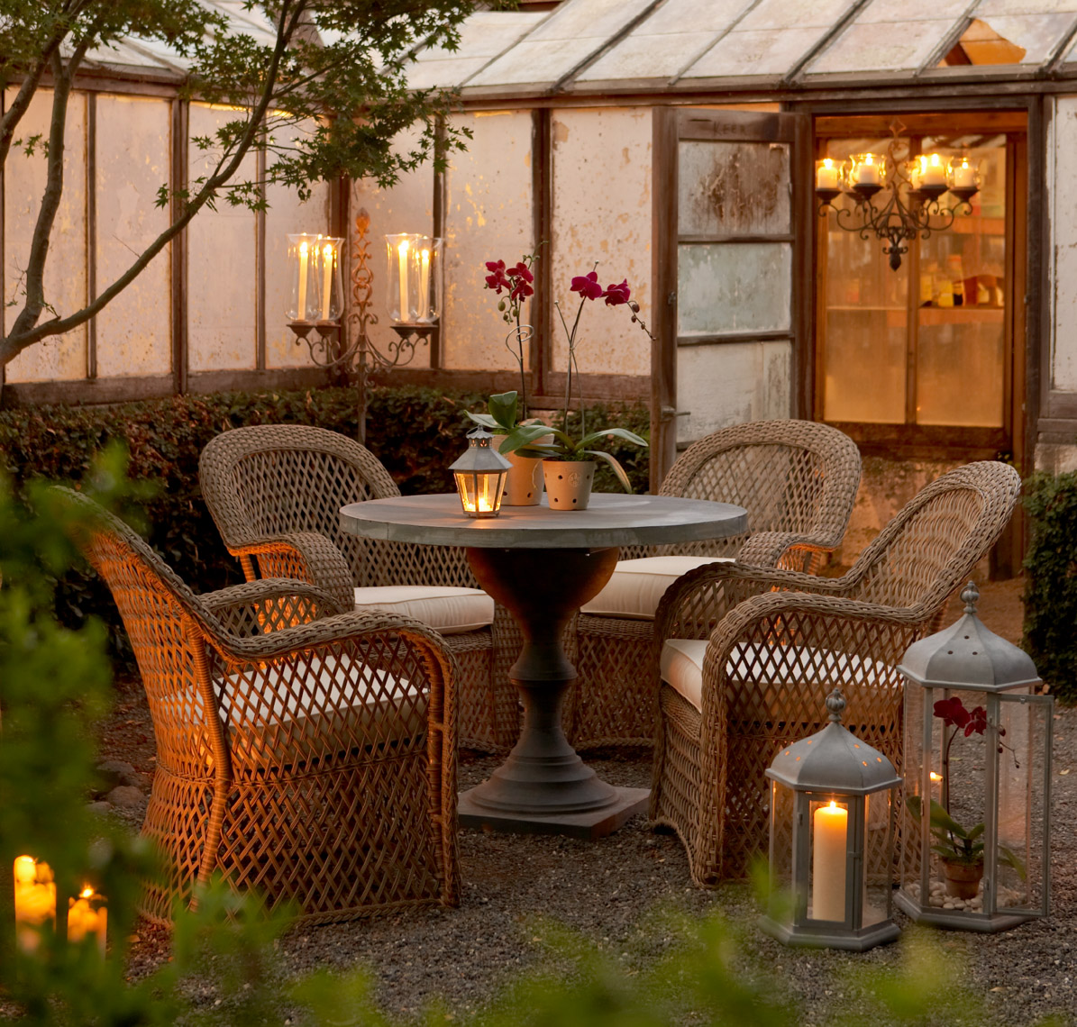 Wicker furniture collection with lanterns at dusk in front of potting shed San Francisco lifestyle photographer