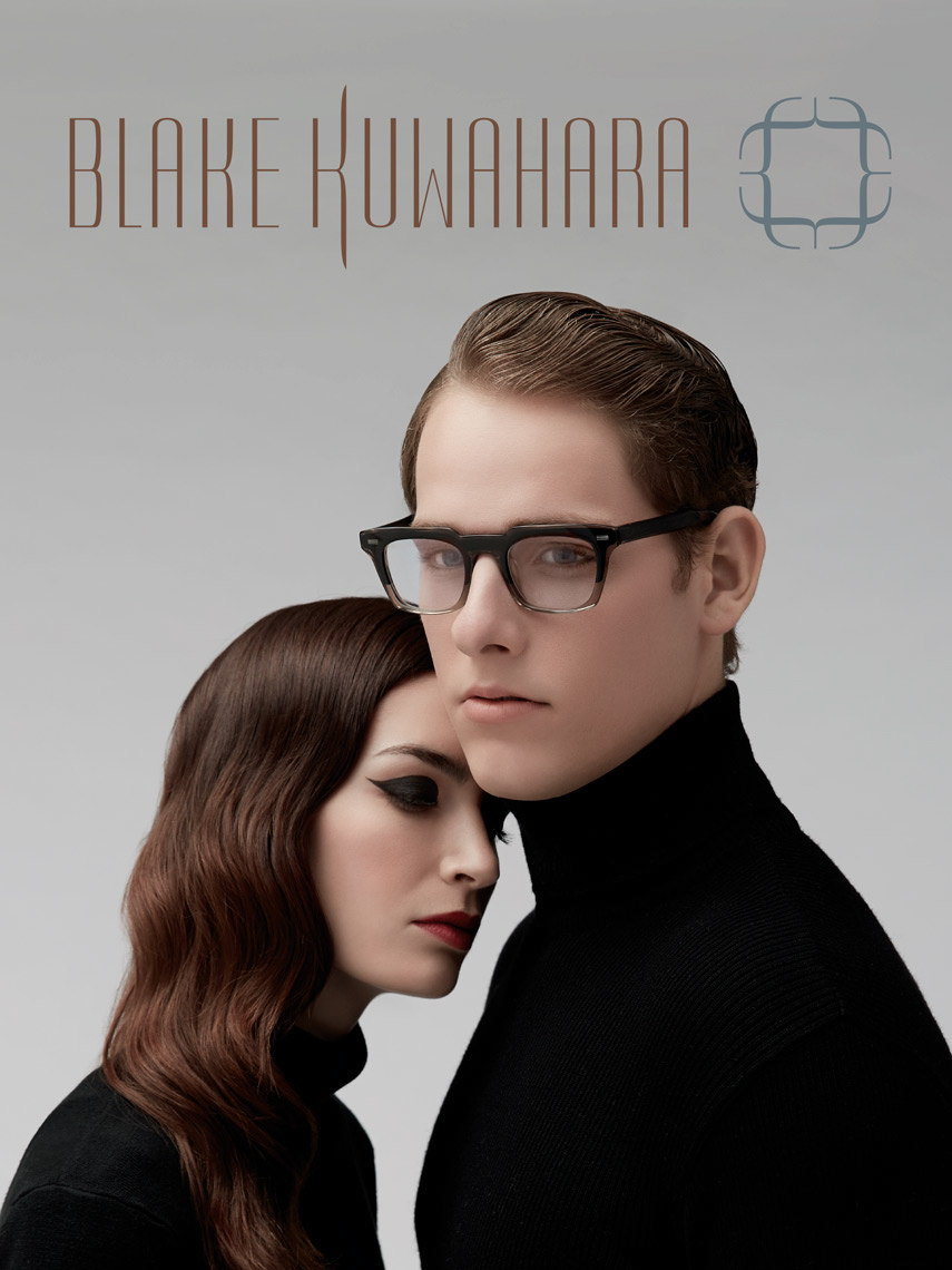 man and woman both wearing black turtlenecks and dark thick frames
